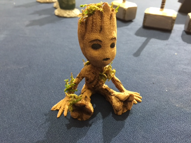 I'm Groot!  Baby Groot, 3D printed with wood filament and embellished with greens.