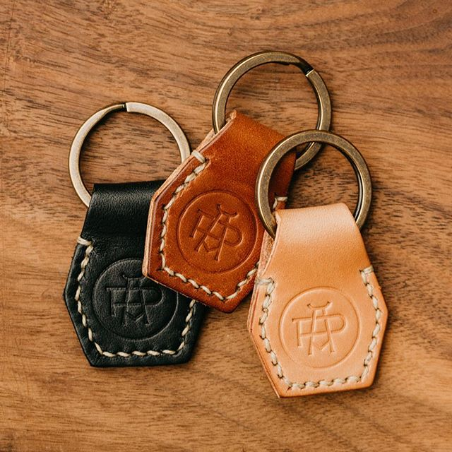 Still looking for a little stocking stuffer?  These keychains are hand-stitched by us and made with vegetable tanned leather from @wickettandcraig, a solid iron key ring with an antique brass finish from @buckleguycom, and stamped with our monogram designed by @alexroka.  Available on our website in the Leather Goods section!