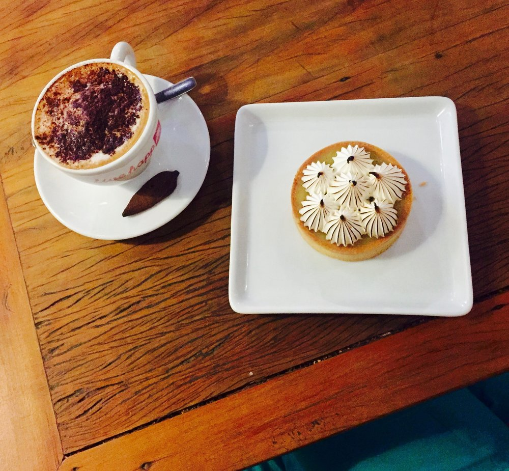enjoying a cappuccino & lemon tart on a solo journey