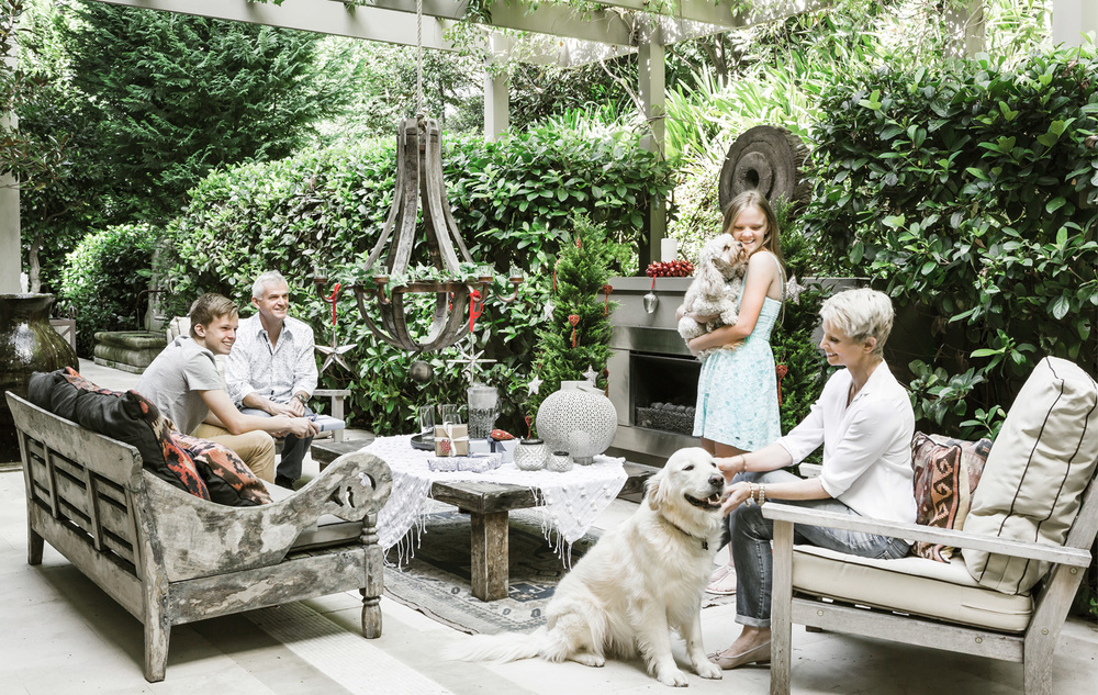 This is a much-used outdoor space for Phil and Ann-Maree Kerry, pictured with children Jack and Isabelle, cavoodle Oscar, and Toby, aloveable goldenretriever with a keen interest in shiny baubles. Photography by maree homer.