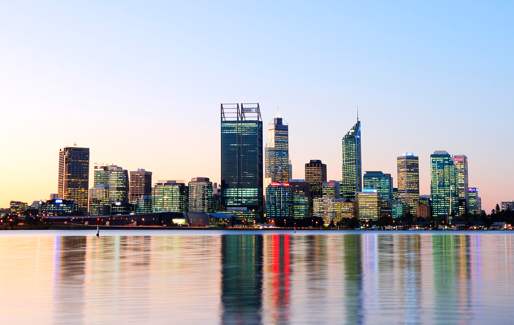 The Perth skyline at twilight, with the 46-storey City Square skyscraper that houses BHP Billiton (middle).  Photography by Louis Liu.