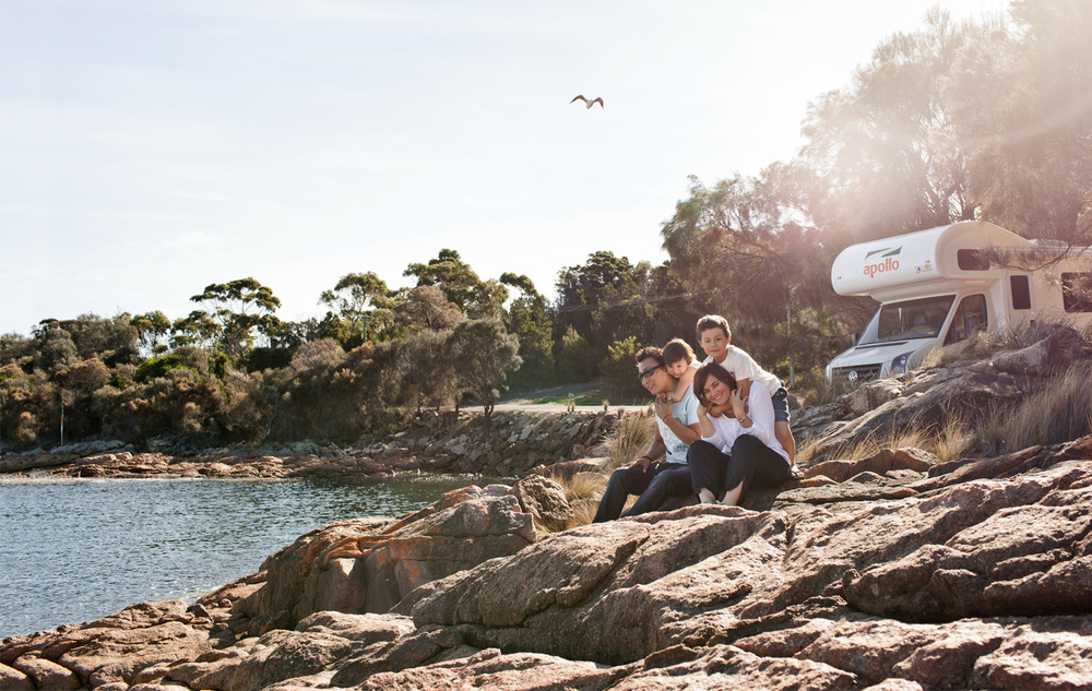 Shakya, Mila, Tsering and Vanessa take in the beauty of Coles Bay on the Freycinet Peninsula, their trusty campervan close at hand.  Photograph by Sean Fennessy.