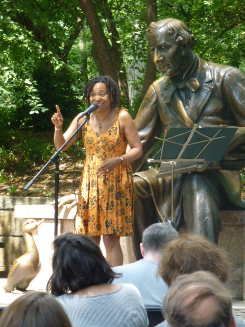 April tells stories at the Hans Christian Andersen Statue