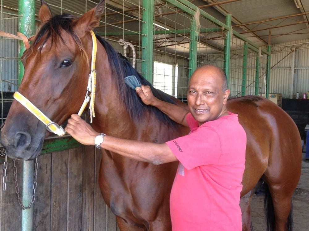 enthusiastic owner pooba govender with his brilliant pacer barimah. pooba races the gelding, who has amassed over $120,000 in stakes, with the Cormack and nicholson families.
