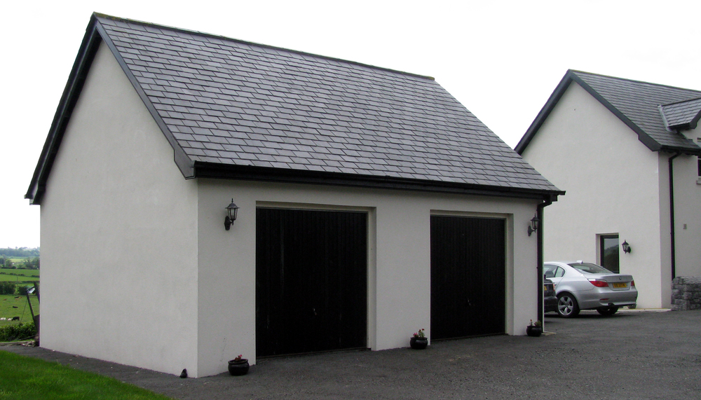 The garage with a Pattini roof in the image above, sits next to a farm house in Northern Ireland overlooking some lush, green pastures and lots of fat cattle!