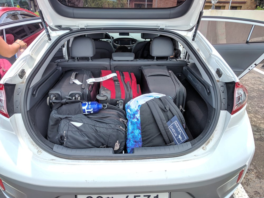 Hyundai Ioniq Electric with 3 medium suitcases and 2 backpacks