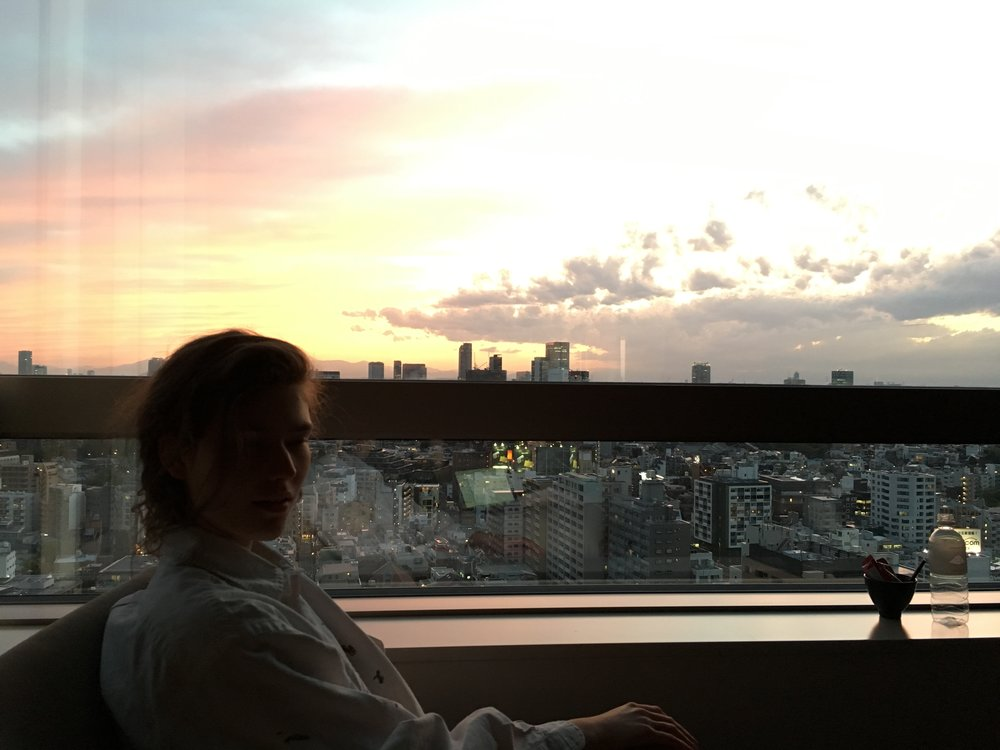 Finishing my paper in my room overlooking Tokyo at dusk