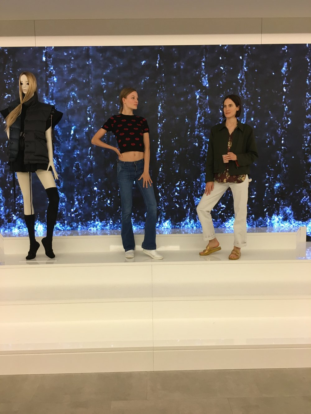 Zara has mock stores under their offices, for practice and layout blueprints. Here the models I worked alongside that week are standing in the mock store window.