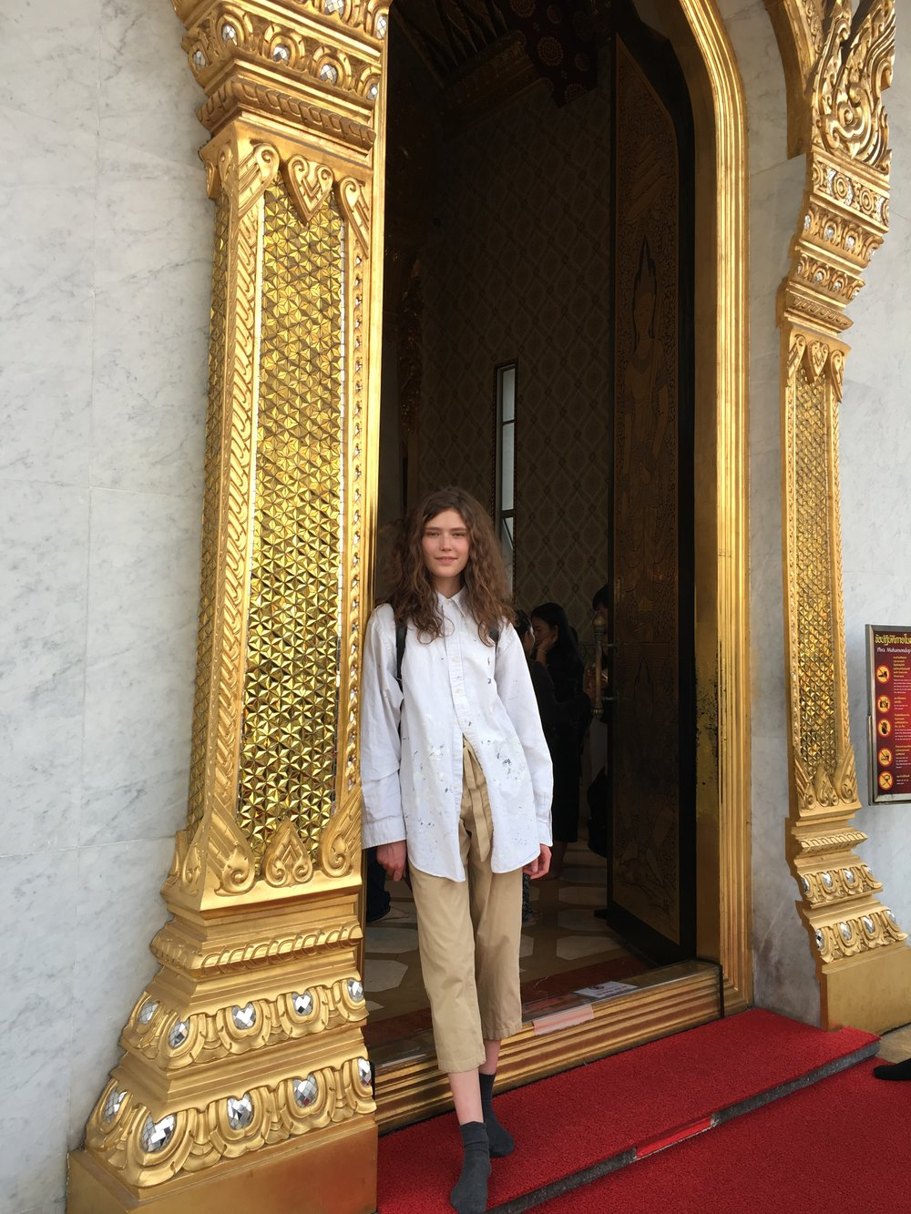 In the entrance of Bangkok's Wat Traimet temple-- no shoes allowed