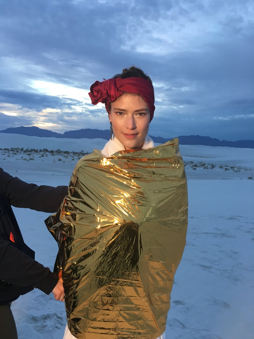 Staying warm in a thermal blanket after sunset when desert temperatures plummet