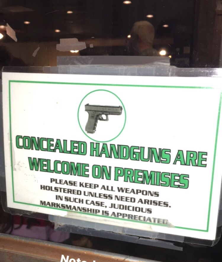 Signage on the door of a restaurant in Alamogordo