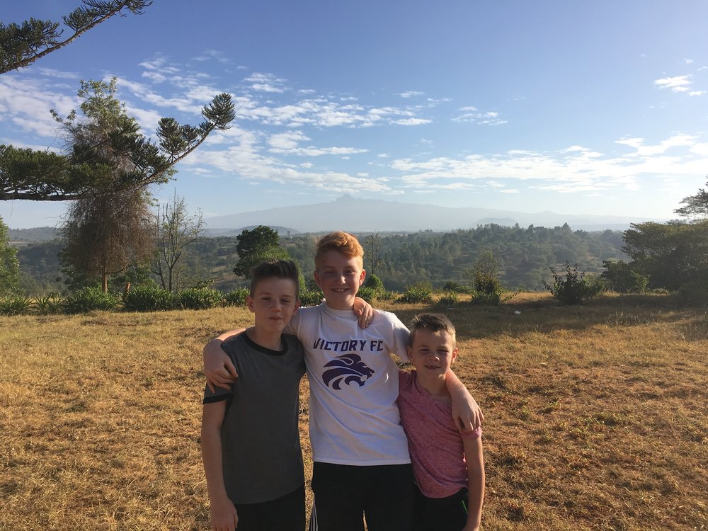 The boys at Karundas Kids Alive home with Mt. Kenya in the background.