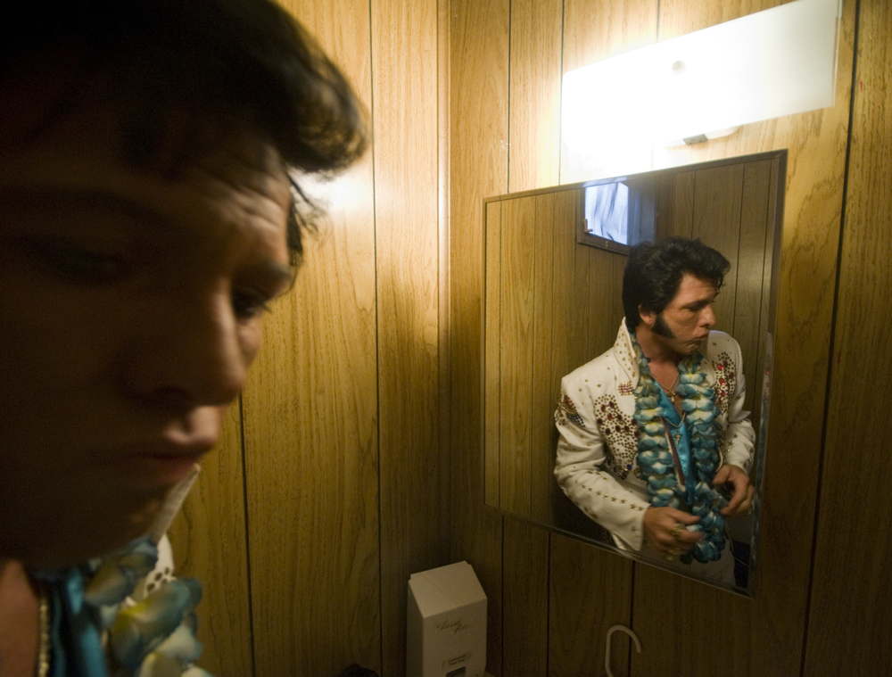 Elvis impersonators prepare for competition at the Wisconsin State Fair.