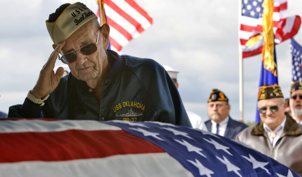 Veterans of World War II honor a shipmate's remains, recently identified and returned from Pearl Harbor.