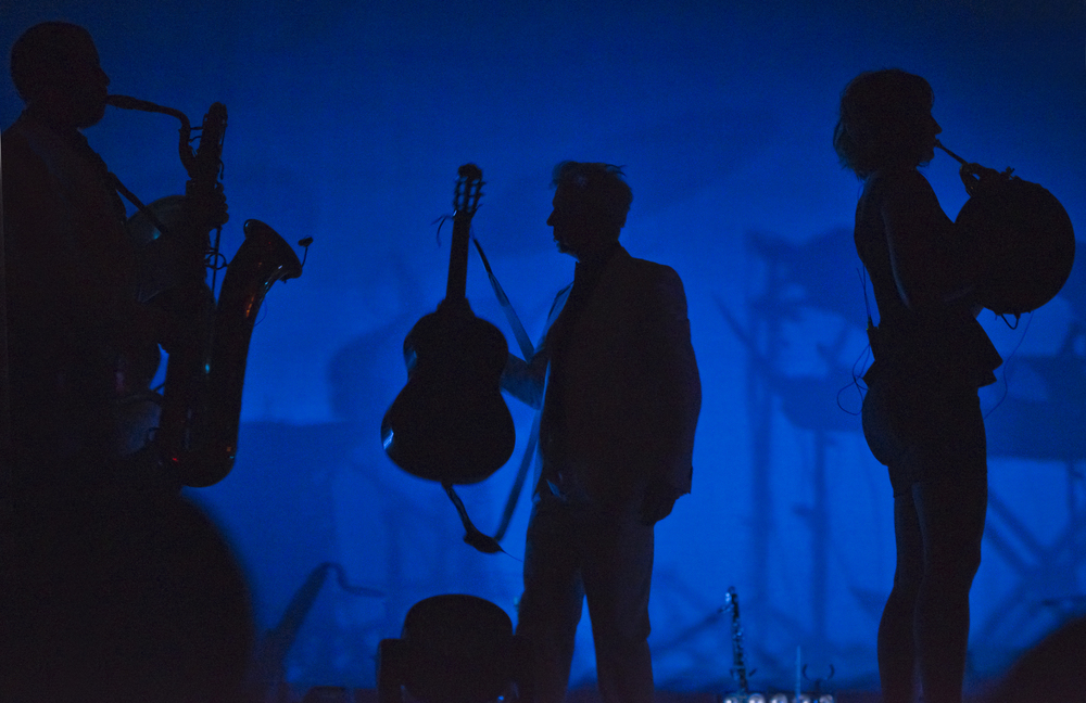 David Byrne onstage during the Love This Giant tour.