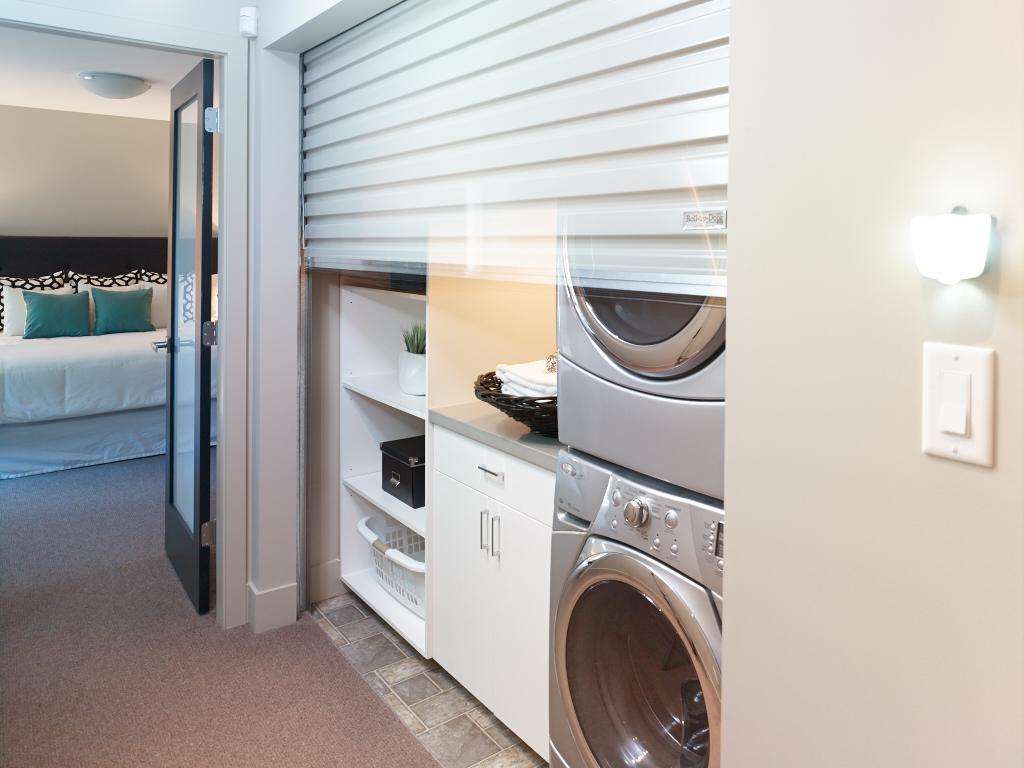 TQ Construction roll-up interior laundry door