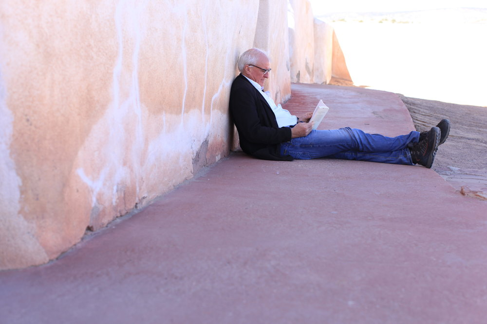 ... whilst Stephen catches up with his reading in the shade of the Mission church.