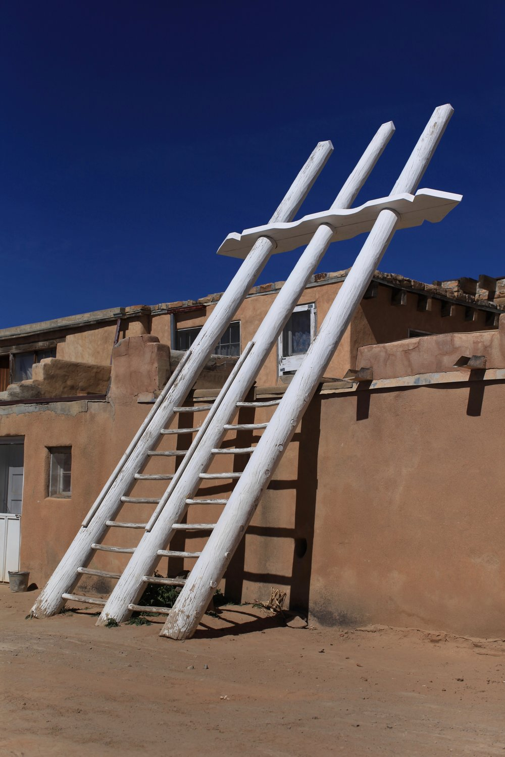 The white ladders that designate a 'kiva' - a house within the Pueblo used for sacred rituals.