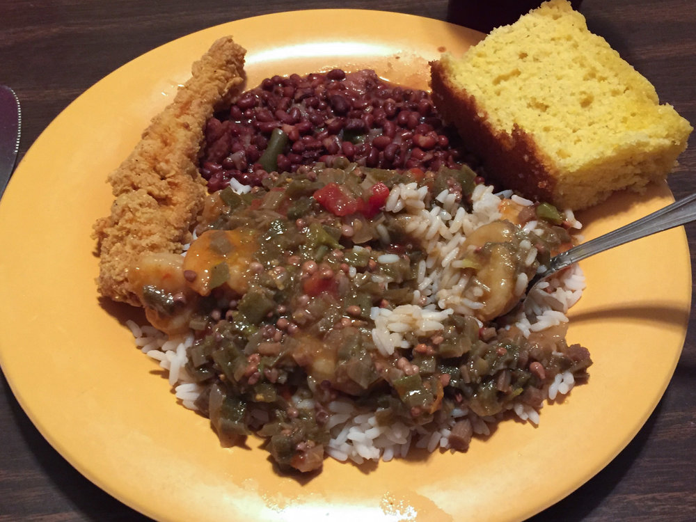 Okra-smothered shrimp, red beans, a side order of fried catfish, and a Southern 'biscuit'.