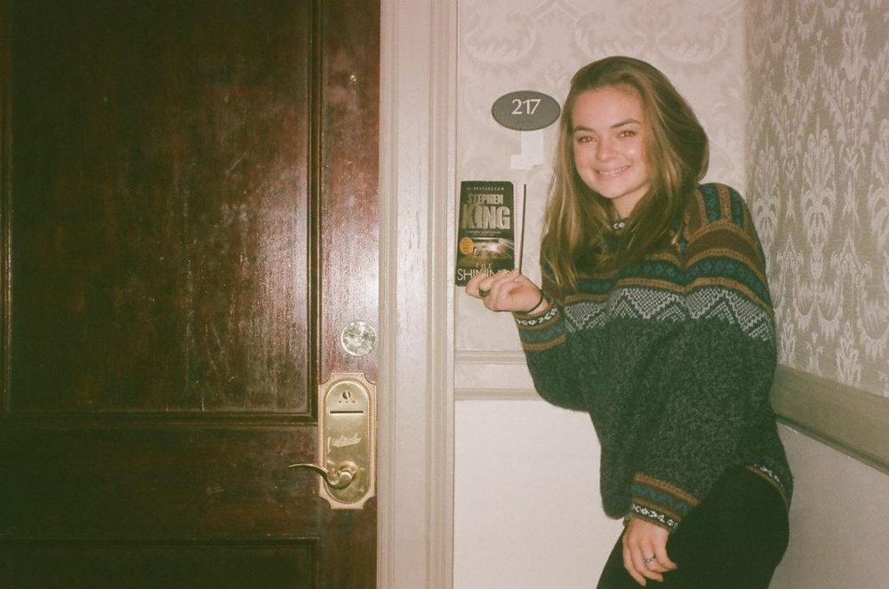 Me standing in front of Room 217, like a true tourist. Spot any orbs? Also, notice the peeling wallpaper under the room badge from where guests had pulled it off the wall.
