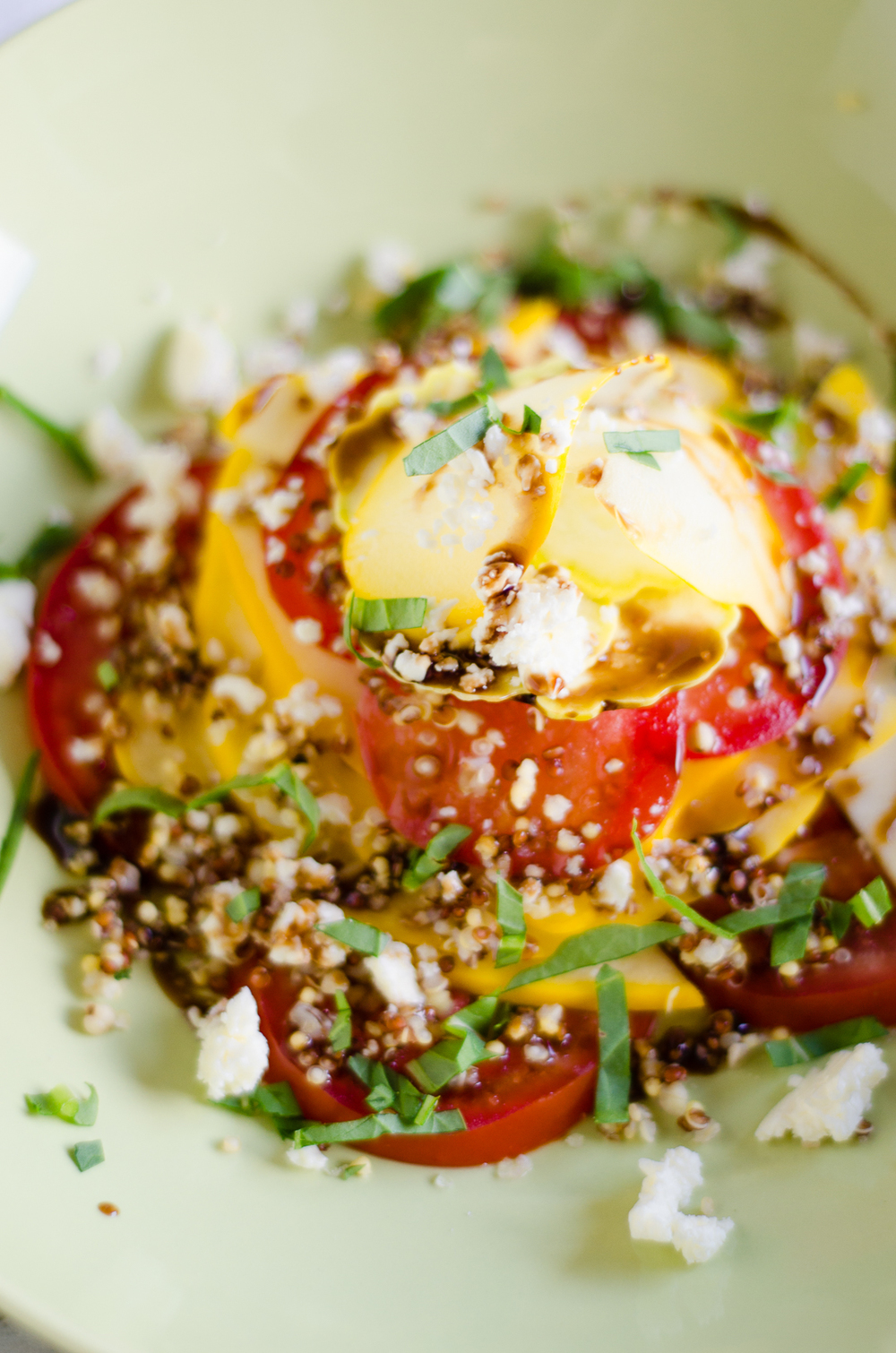 Pattypan & Tomato Salad with Balsamic Dressing, Feta, Arugula. - This delightful early summer vegetarian salad recipe is suitable for plant-based eaters. Features farro & squash. thenomadicwife.com