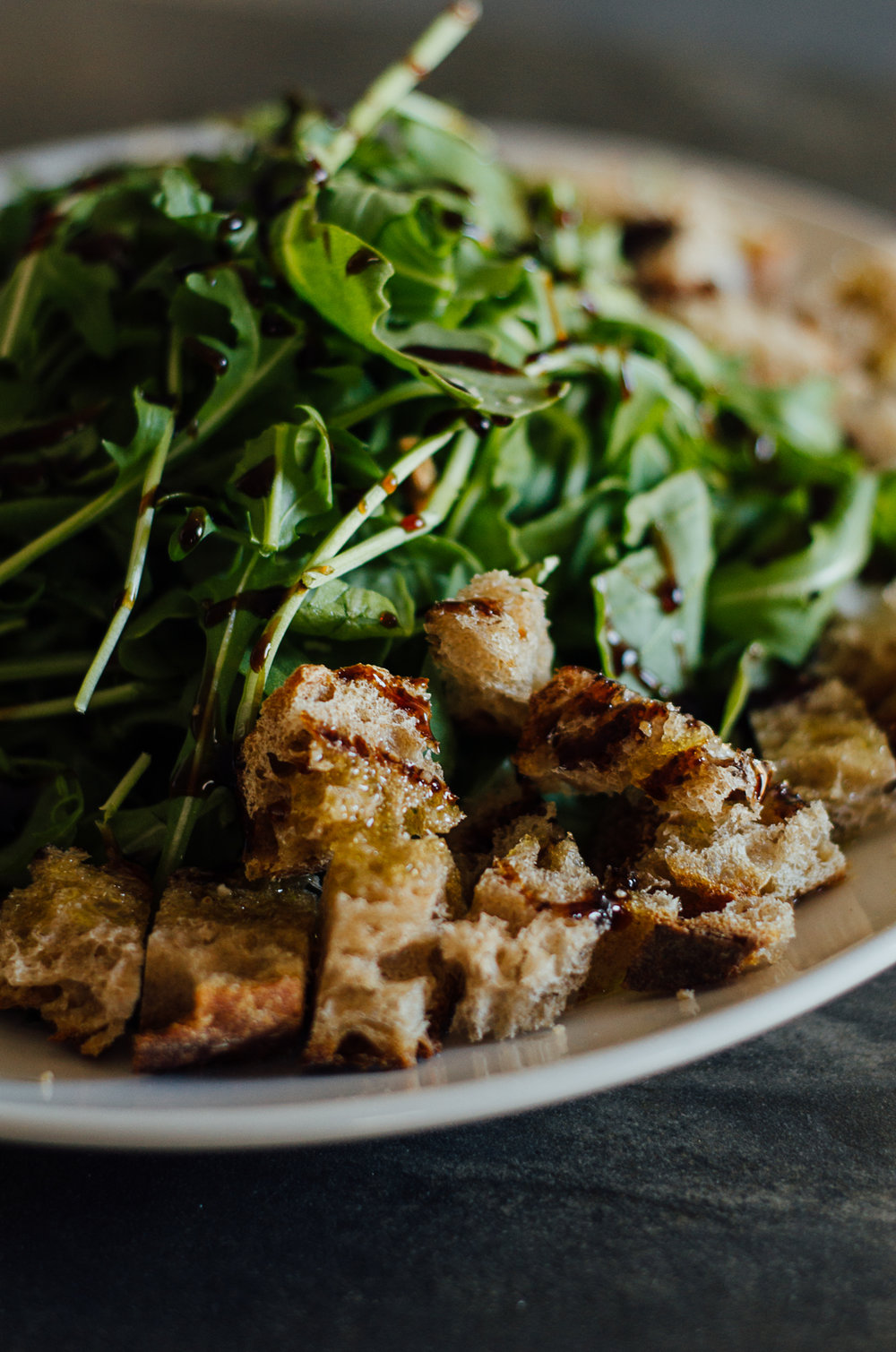 simple croutons and arugula salad