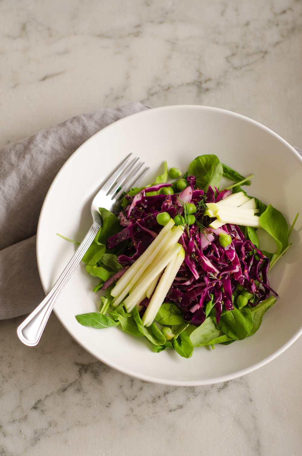 Red cabbage, chickpea & apple salad by the nomadic wife