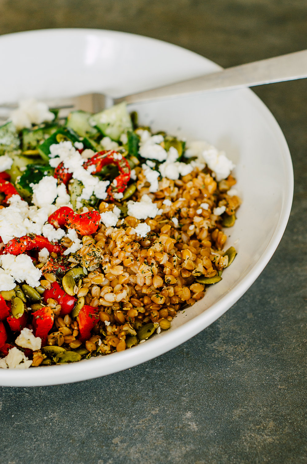 greek salad bowl with farro and nettle - the nomadic wife