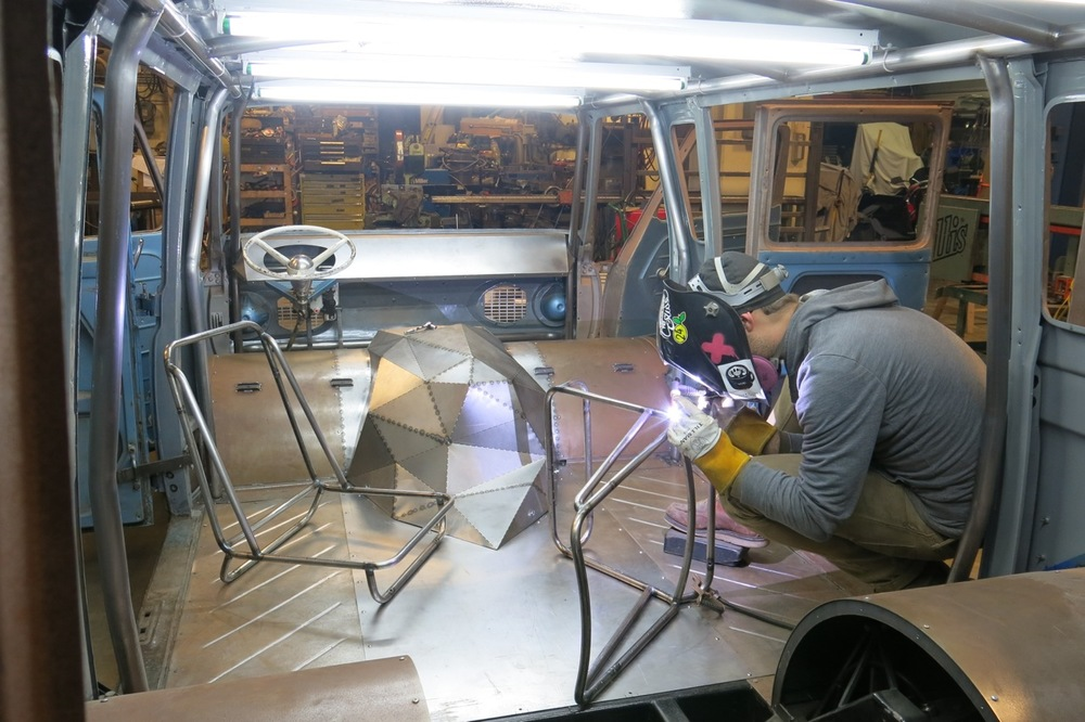 Welding up the lawn chair inspired seat frames. On more than one occasion I've worked inside the van as it has some of the best light in the studio.
