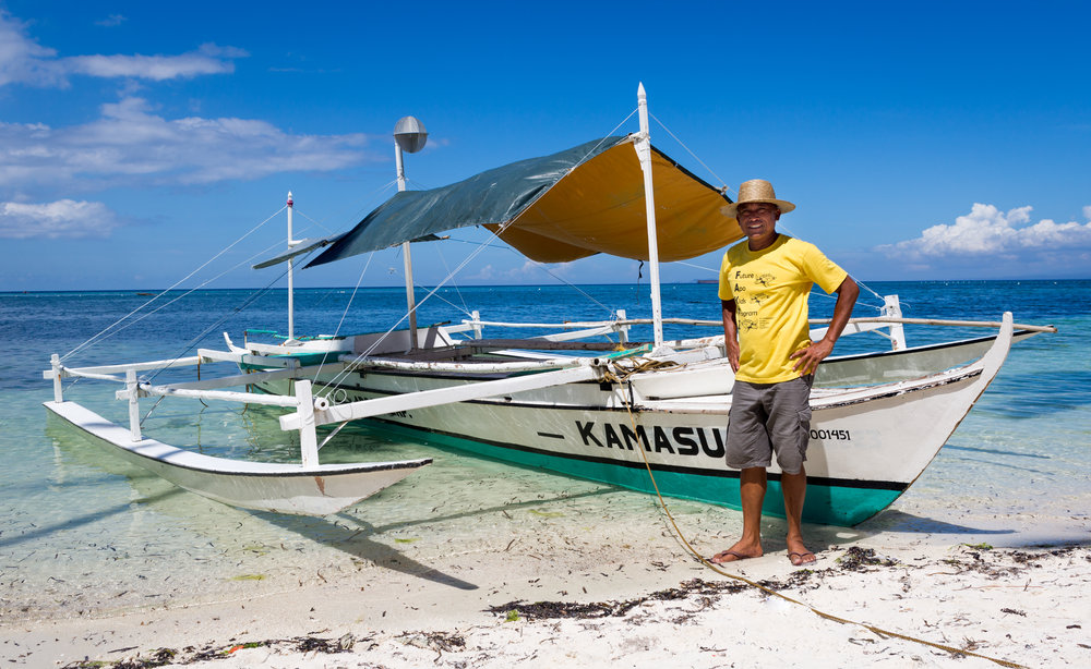 Mario Pascobello standing by his boat at Siquijor Island