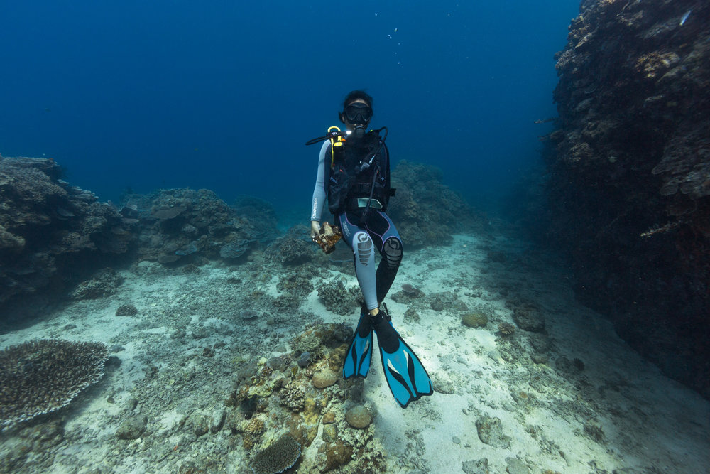 Mary Jean, a proud new dive master, exploring the underwater world of Danjugan Island, Philippines