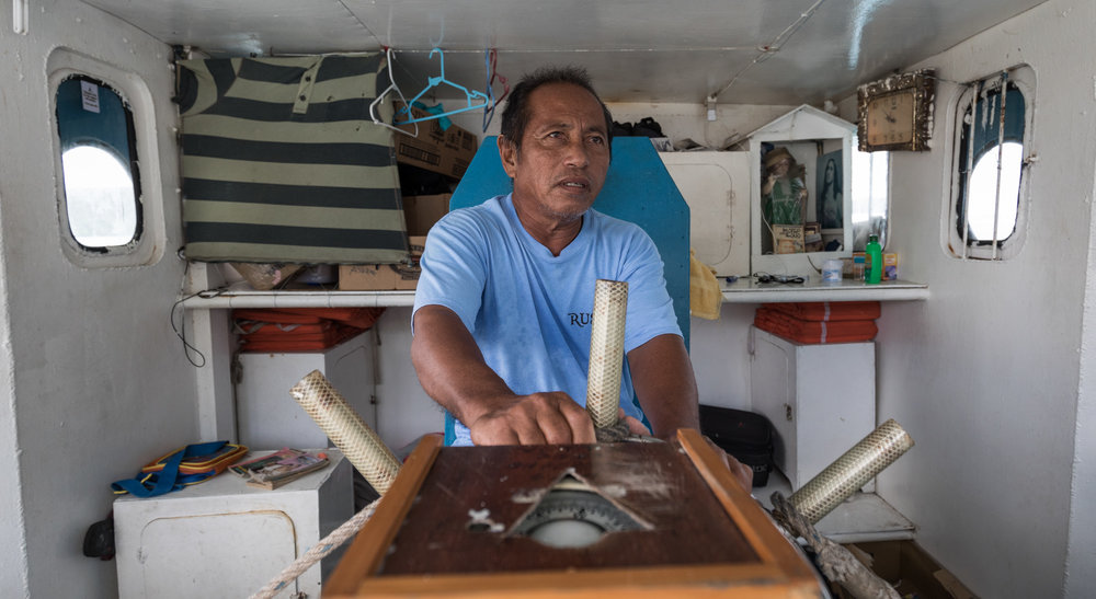 In June 2017, we found Captain Ruffino sitting under house arrest at his ship's wheel in Palau.