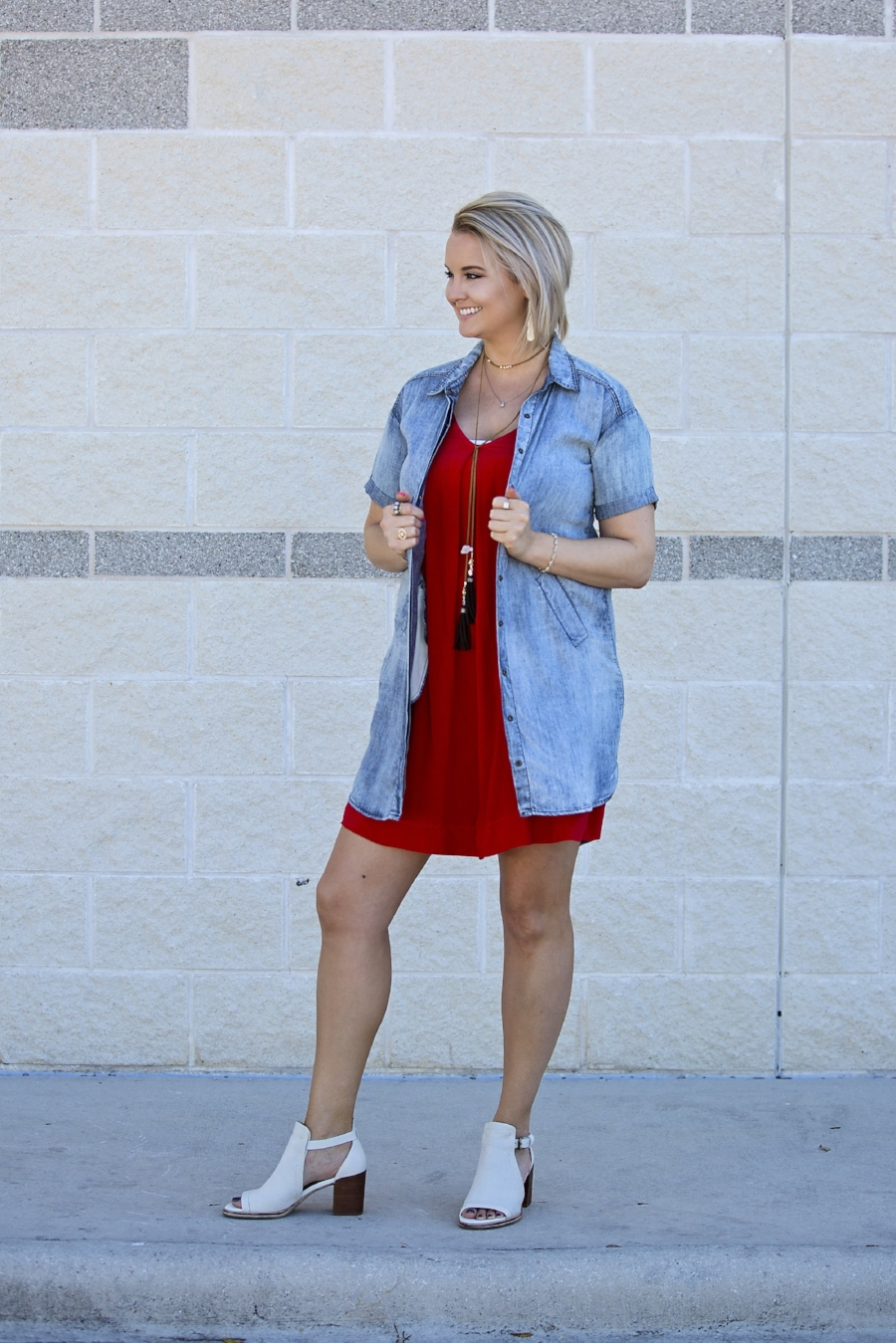 Kellea is wearing a gorgeous red Michael Stars dress with a pair of OTBT shoes with this outfit.