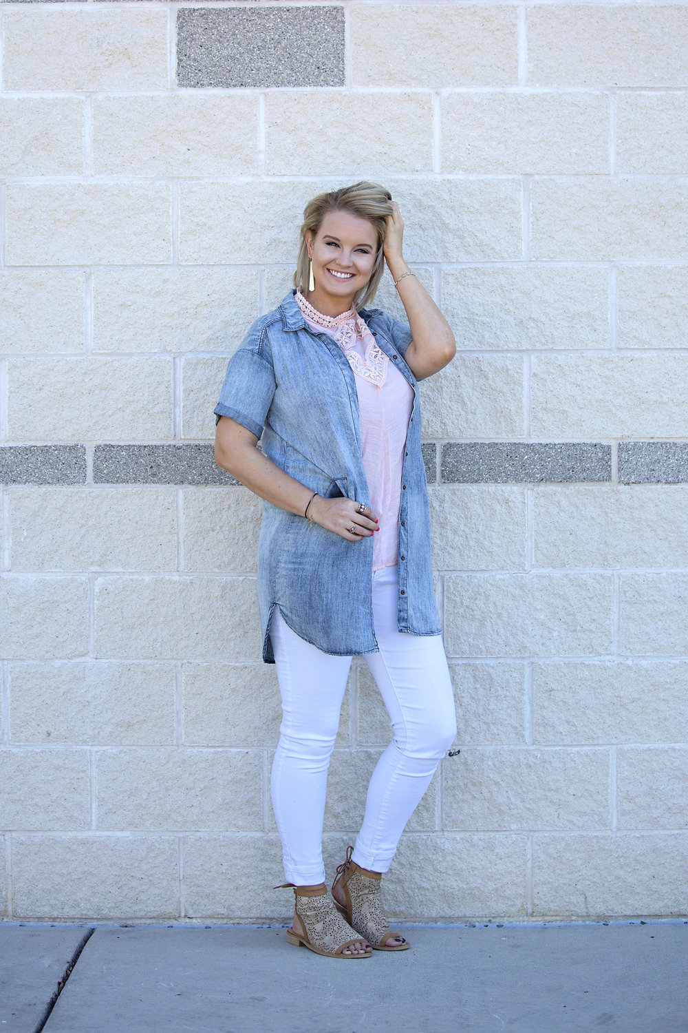 Kellea chose a pink She & Sky top with white PAIGE pants for this look.