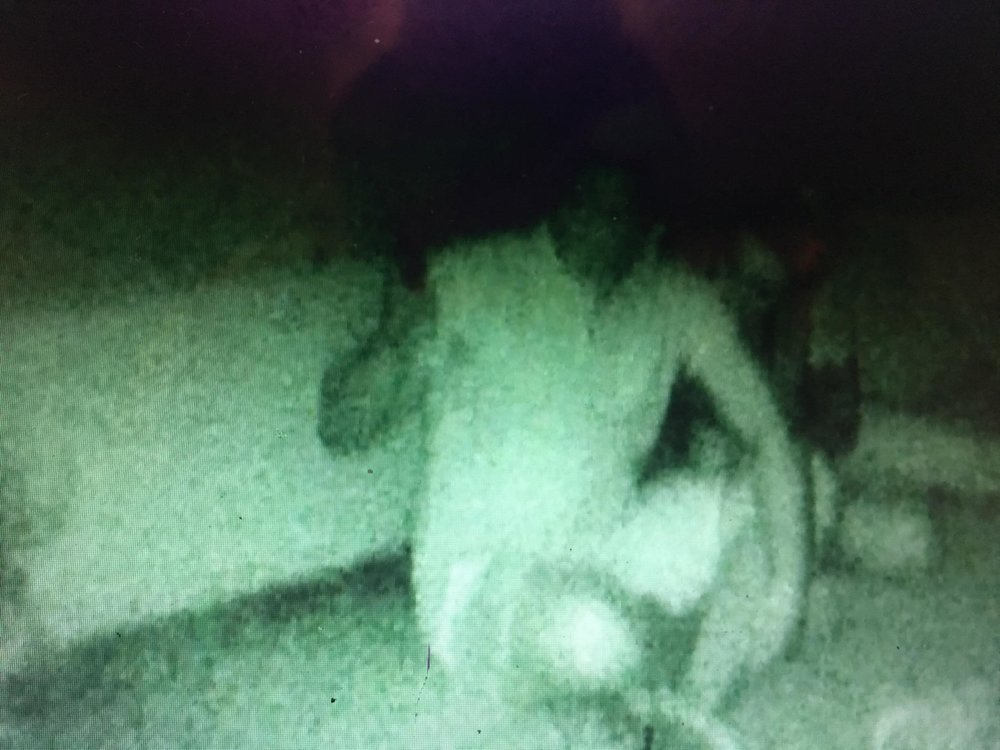 Child's face in crook of B&B guest's arm during our seance.
