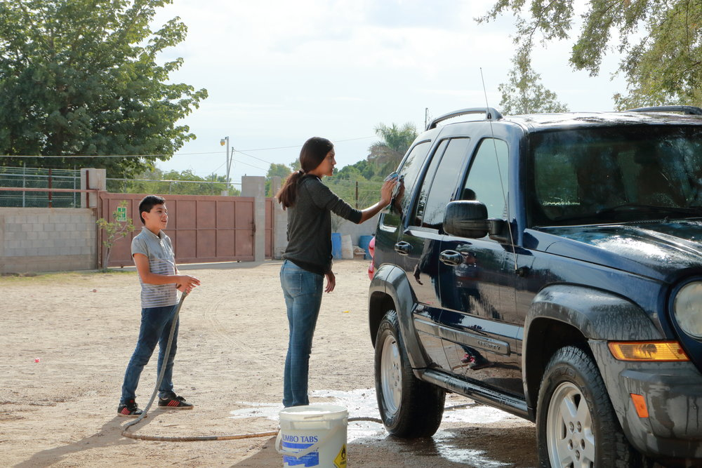 Washing our car - Once a week the kids from the home wash our car. It gives them a little spending money and it gives us a clean car for a week. It is a win, win