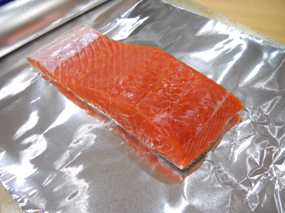 So easy, add your salmon to aluminum foil that can cover the whole slab.