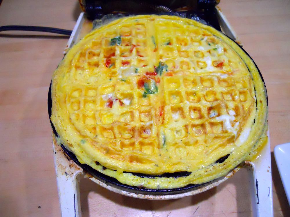 Cooking in my mother's old waffle iron almost ready to remove. Let it sit for a few seconds first.