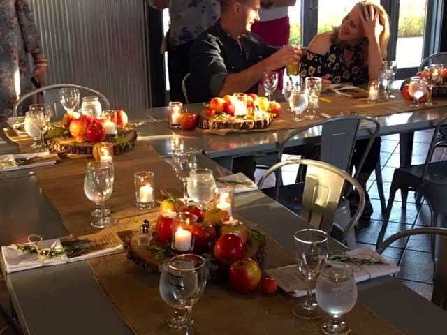 Guests September 20, 2018 were greeted with these lovely table scapes of apples and candles.