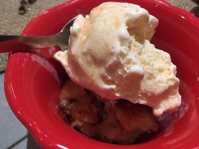 Dessert. An apple crisp topped with ice cream, perfect ending to a trip through apple land.