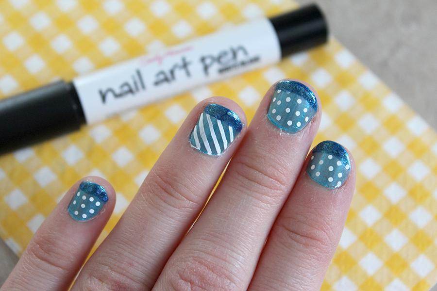 diy tutorial blue and white polka dot nail art