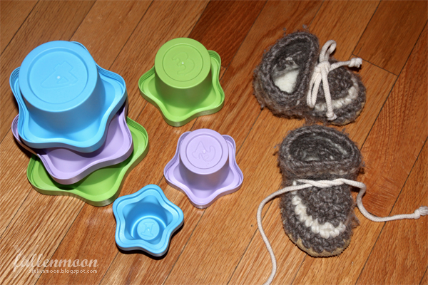 stacking cups and baby wool slippers