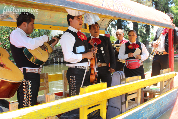 mariachi playing on boat