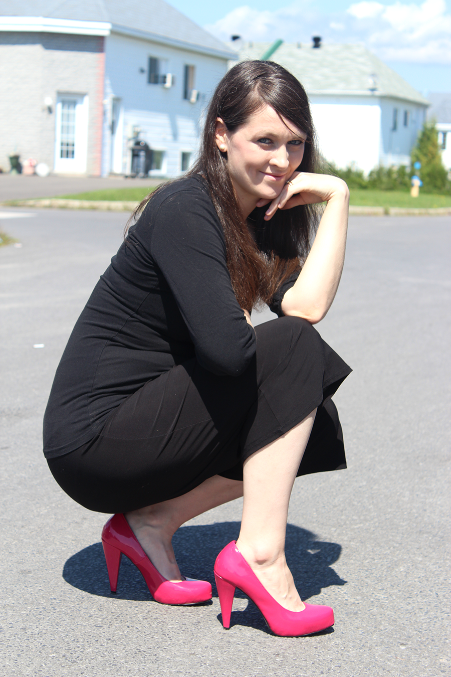 crouching with pink heels