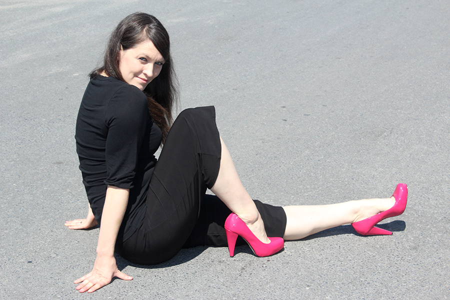 sitting on the street in fushia heels