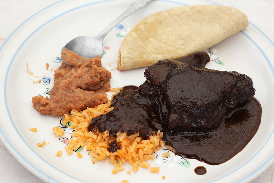 refried beans with mole rojo is a delicious mexican meal