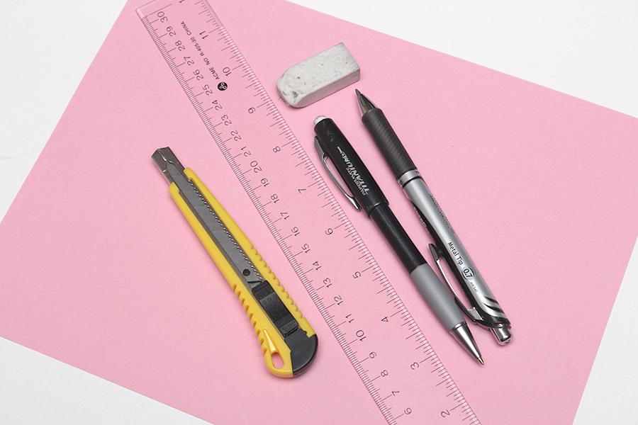 paper ruler pencil eraser
