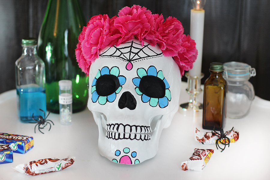 Make a bright and colorful sugar skull candy bowl to decorate your home for Halloween. Click to see the tutorial.