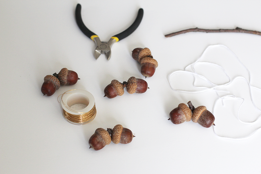 Materials to make an acorn mobile decoration.