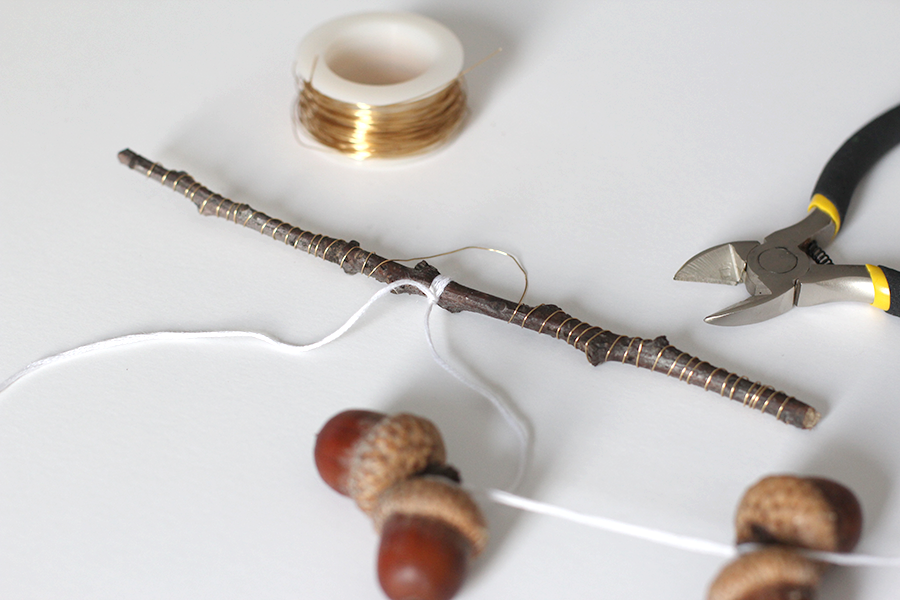 Attach the tied acorns to the wire wrapped branch.